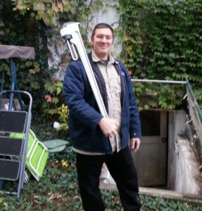 Tony Franzen with his large wrench used for really large air conditioning and heating jobs